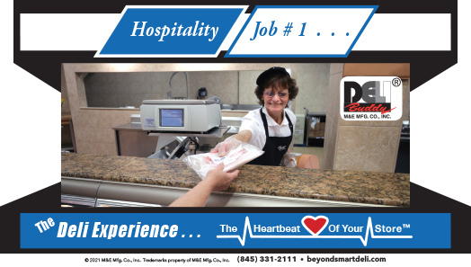 Smiling deli associate handing package over a deli counter
